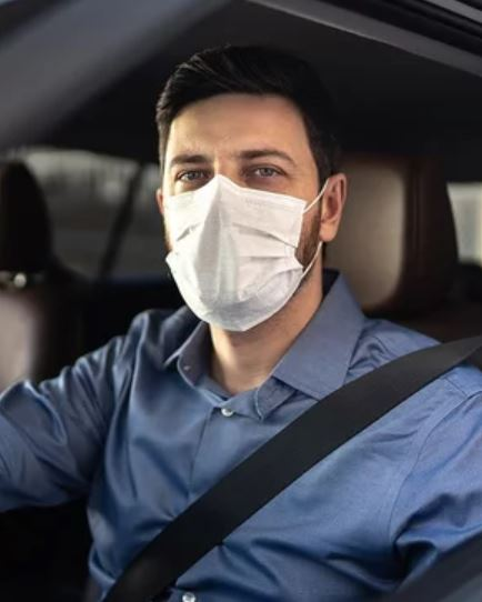 Driver-with-a-face-mask
